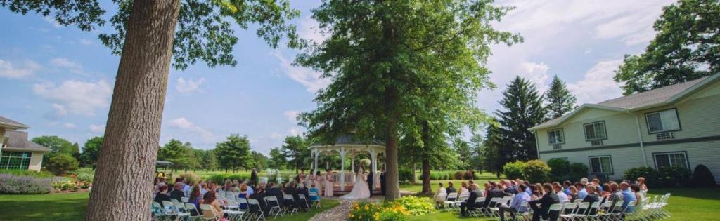 view of an outdoor wedding at Swan Lake Resort