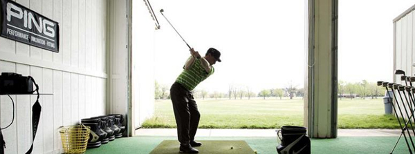 A golfer uses the indoor facilities at the Golf Academy at Swan Lake Resort